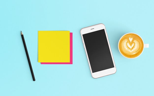 Moderne werkruimte met koffiekopje, kladblok en smartphone op blauwe kleur
