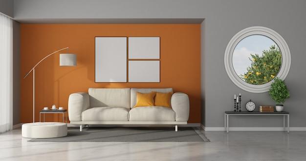 Moderne woonkamer met ronde raam op grijze muur