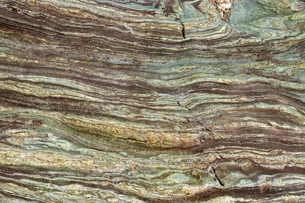 Mooi detail van patronen op natuursteen, abstracte textuur op stenen behangachtergrond
