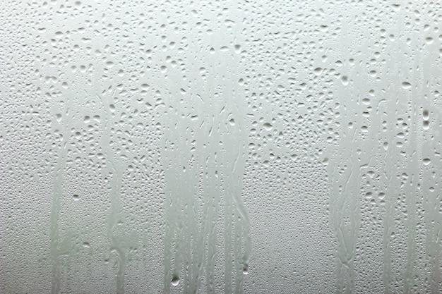 Mooi vensterglas met druppels achtergrond