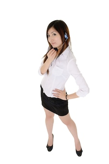 Mooie bedrijfsvrouw met hoofdtelefoon status