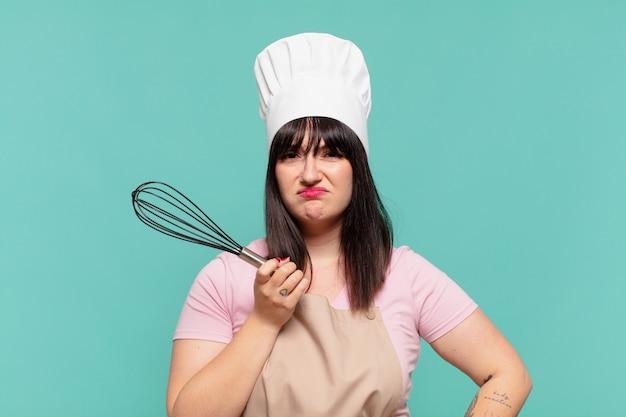 Mooie chef-kok vrouw droevige uitdrukking