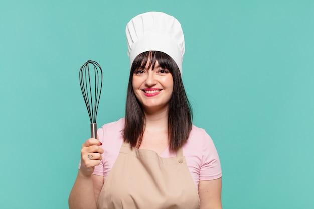 Mooie chef-kok vrouw gelukkige uitdrukking