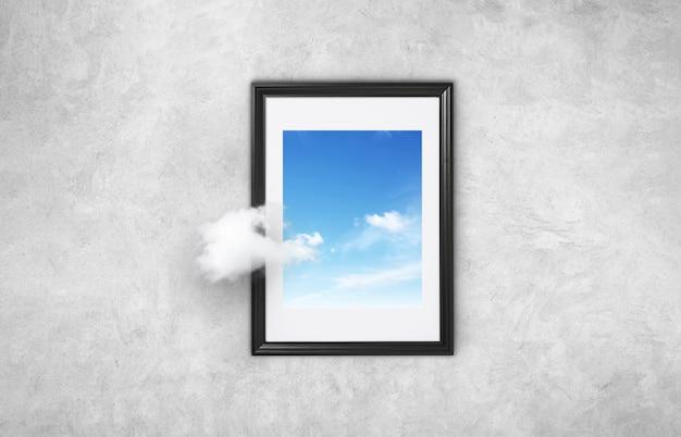Mooie foto met een zwart frame met blauwe lucht en wolken op een grijze betonnen muur. concept denkt anders. verder gaan. denk buiten de kaders surrealistisch minimaal concept