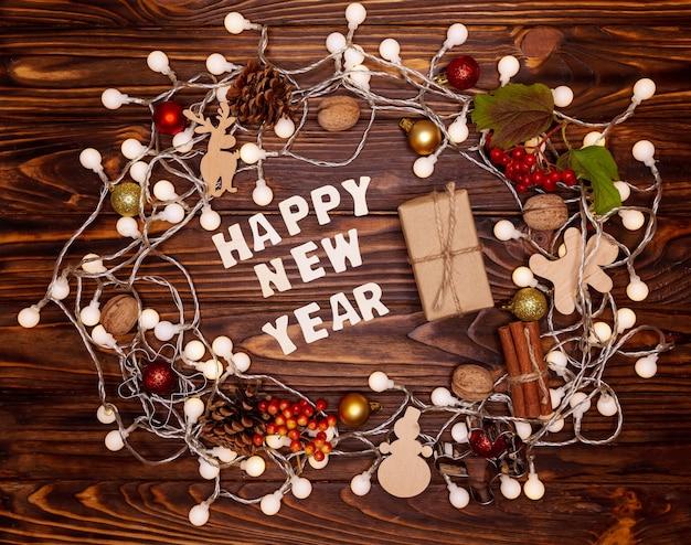 Mooie gezellige xmas achtergrond. vrolijk kerstfeest van houten letters Premium Foto