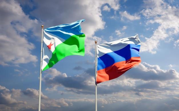 Mooie nationale vlaggen van djibouti en rusland samen op blauwe hemel. 3d-illustraties