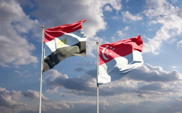 Mooie nationale vlaggen van egypte en singapore samen