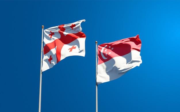 Mooie nationale vlaggen van georgië en singapore samen