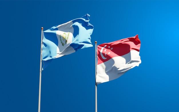 Mooie nationale vlaggen van guatemala en singapore samen