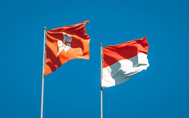 Mooie nationale vlaggen van hong kong hk en indonesië samen op blauwe hemel