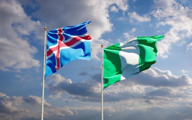 Mooie nationale vlaggen van ijsland en nigeria samen op blauwe hemel