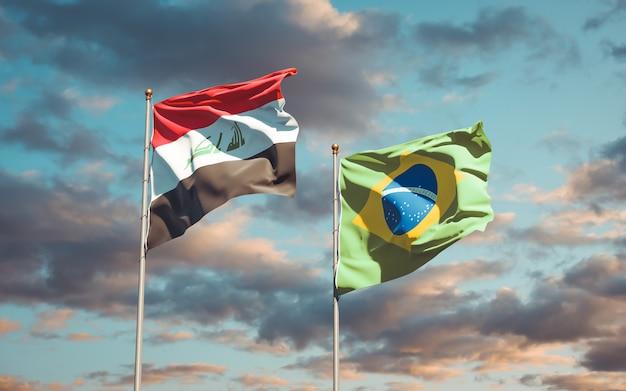 Mooie nationale vlaggen van irak en brazilië samen op blauwe hemel