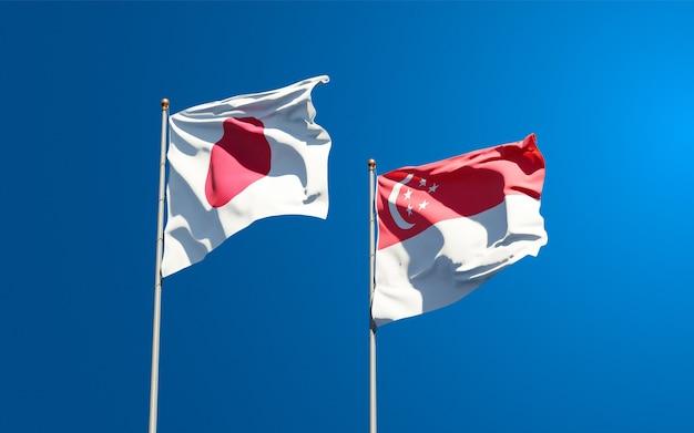 Mooie nationale vlaggen van japan en singapore samen