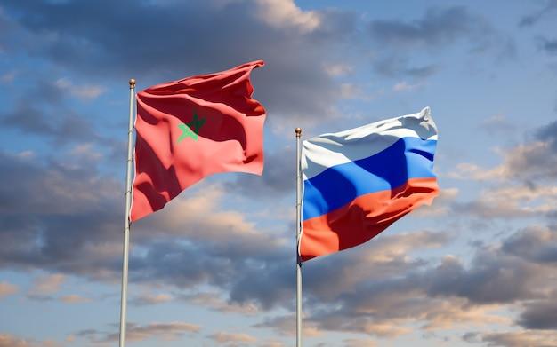 Mooie nationale vlaggen van marokko en rusland samen op blauwe hemel. 3d-illustraties