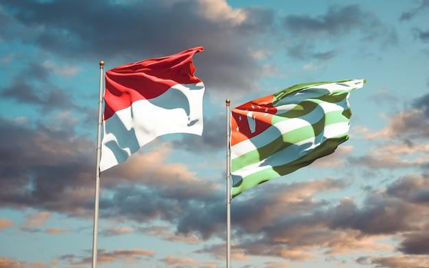Mooie nationale vlaggen van monaco en abchazië samen