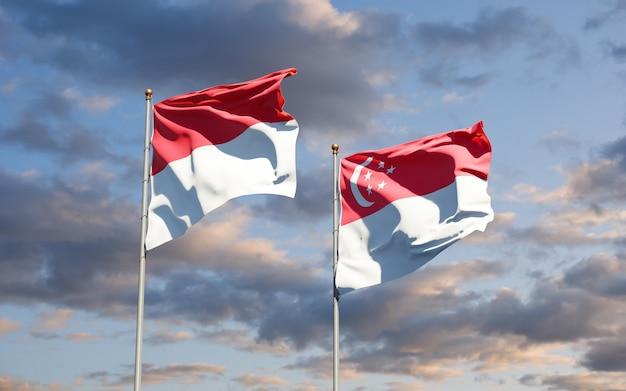 Mooie nationale vlaggen van monaco en singapore samen