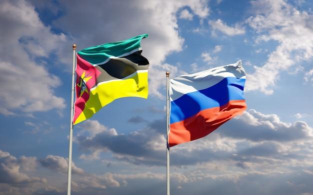 Mooie nationale vlaggen van mozambique en rusland samen op blauwe hemel. 3d-illustraties