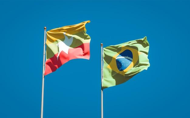 Mooie nationale vlaggen van myanmar en brazilië samen op blauwe hemel