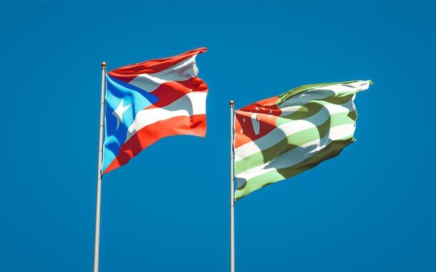 Mooie nationale vlaggen van puerto rico en abchazië samen