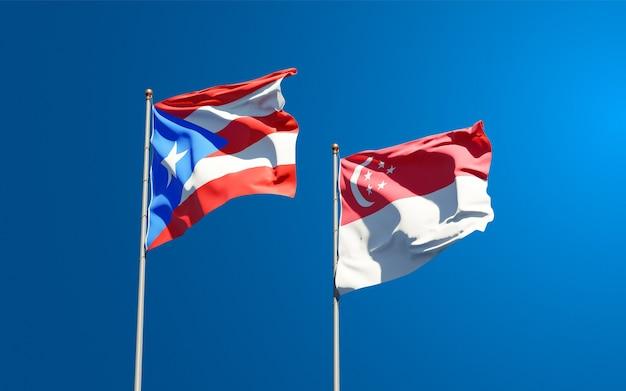 Mooie nationale vlaggen van puerto rico en singapore samen