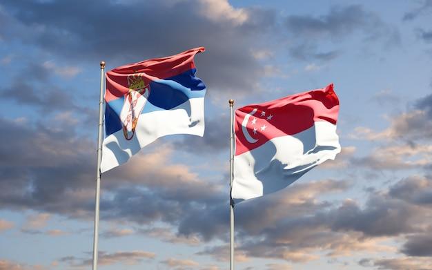 Mooie nationale vlaggen van servië en singapore samen