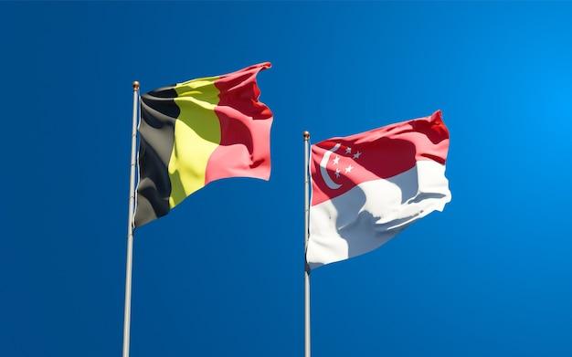 Mooie nationale vlaggen van singapore en belgië