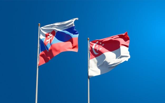 Mooie nationale vlaggen van slowakije en singapore samen