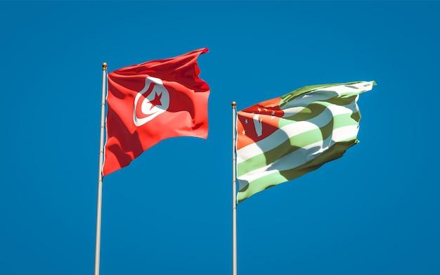 Mooie nationale vlaggen van tunesië en abchazië samen