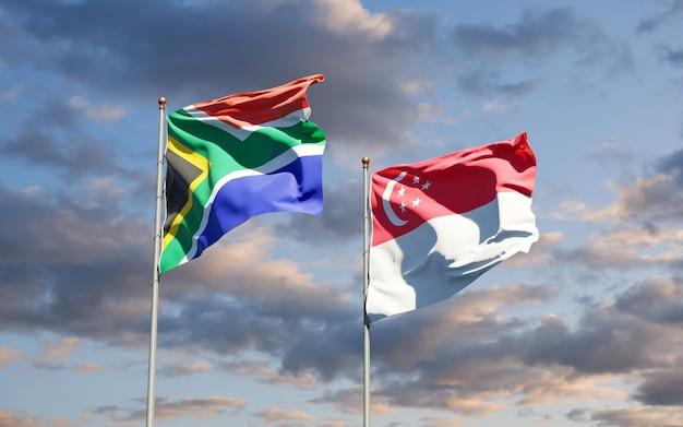 Mooie nationale vlaggen van zuid-afrika en singapore samen