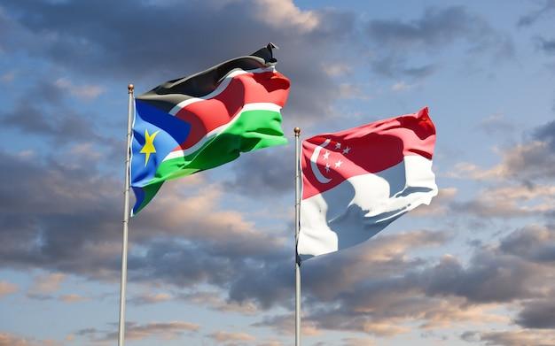 Mooie nationale vlaggen van zuid-soedan en singapore samen