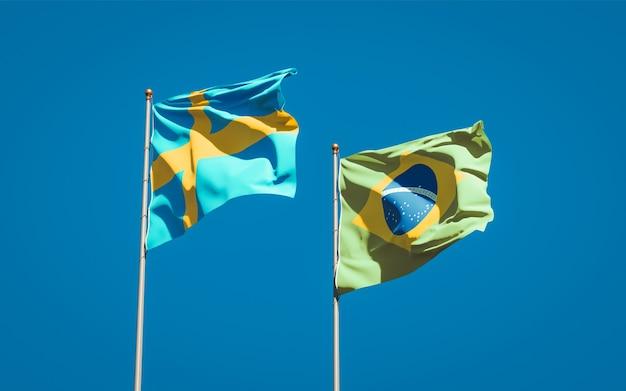 Mooie nationale vlaggen van zweden en brazilië samen op blauwe hemel