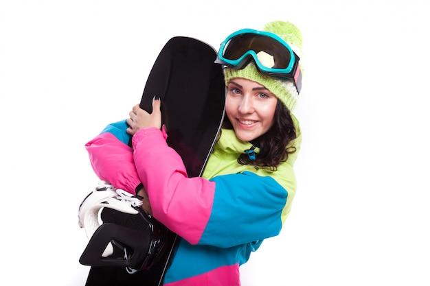Mooie ski vrouw knuffel snowboard