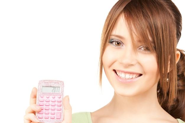 Mooie tienermeisje met rekenmachine over white
