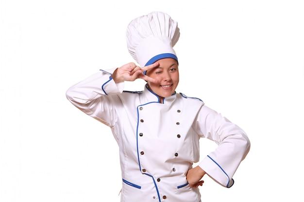 Mooie vrouw in chef-kokbeeld