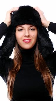 Mooie vrouw in hoed