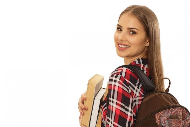 Mooie vrouwelijke student met een rugzak