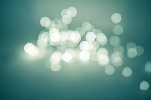 Mooie wazige bokeh, veel heldere artistiek vervaagde cirkels. kerst achtergrond.