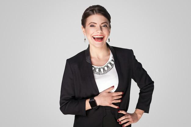 Mooie zakenvrouw lach en brede glimlach