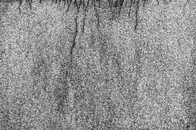 Mortier stenen loopbrug met zwarte vlek. zwart en wit van abstracte achtergrond. minimalisme architectuur. details van de moderne patroonbouw.