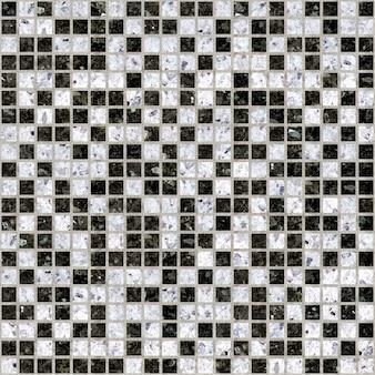 Mozaïek in wit en zwart marmer. keramische tegel