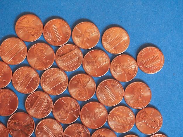 Munten van één cent dollar, verenigde staten over blauw