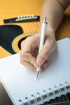 Music composer hand writing songs