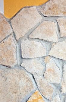 Muur bekleed met porfierstenen achtergrond