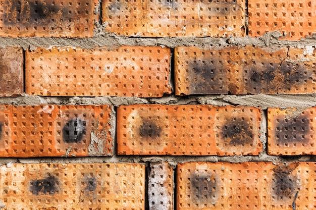 Muur gemaakt van bakstenen oppervlak