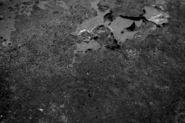 Muur met roest. oppervlak van roestig metaal. roestig ijzer textuur. afgezwakt zwarte kleur