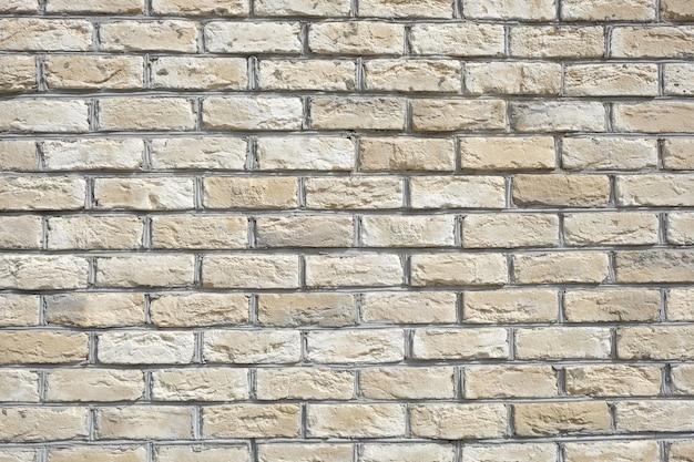 Muur van beige bakstenen horizontale foto vooraanzicht close-up
