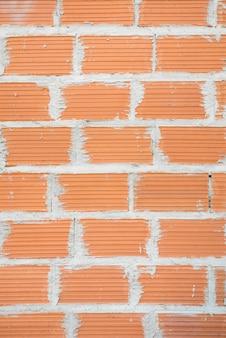Muur van bruine bakstenen