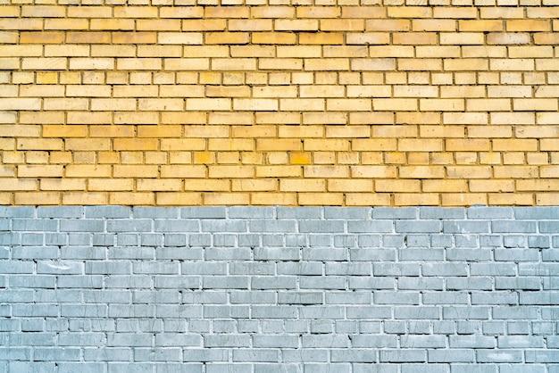 Muur van gele en grijze bakstenen