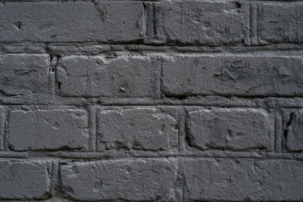 Muur van grijze bakstenen of betonnen muur.
