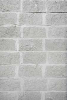 Muur van grijze bakstenen